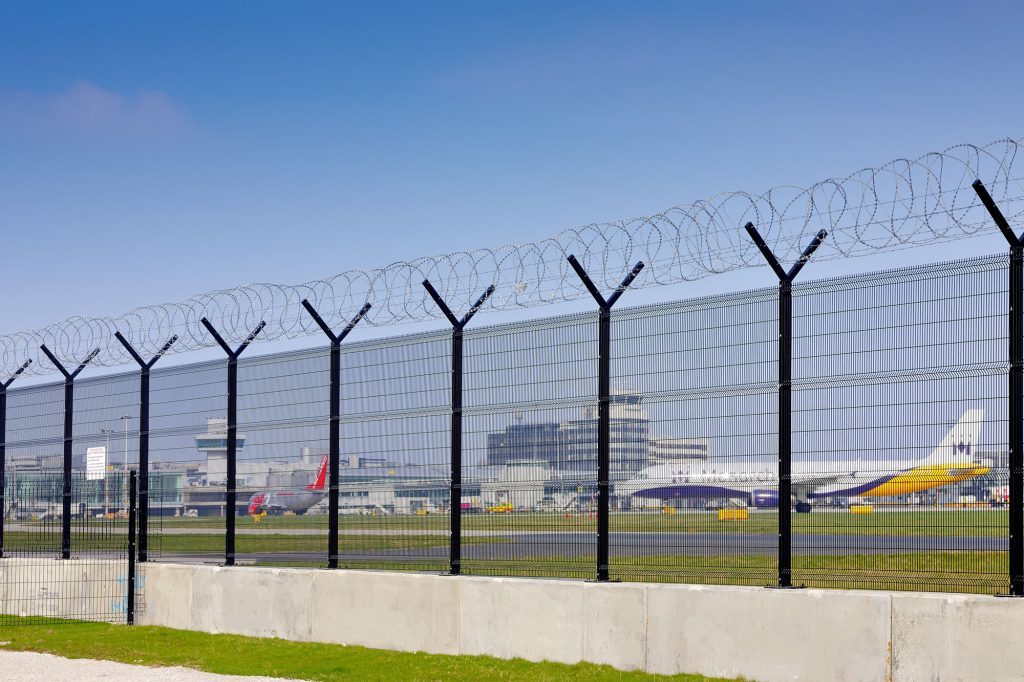 Jet aircraft behind high security fence